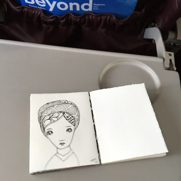 Grace Mendez Mini Art Journal on Plane