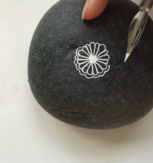 Grace Mendez Painting Rocks Detail