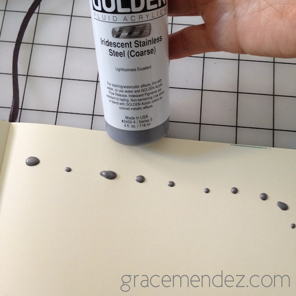 Grace Mendez Scraping Grey Paint on Art Journal Page